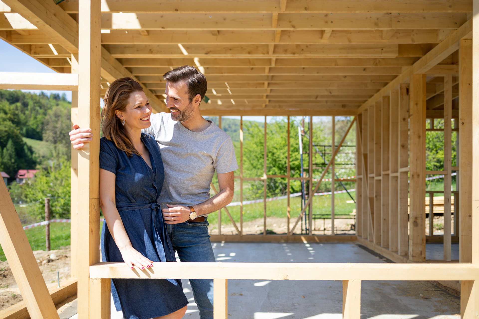 House and Land for Sale - woman and man on wooden support